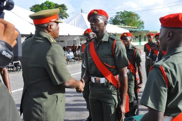 Chief of Staff, Brigadier General Mark Phillips (left) charged the graduates to set the example and be positive role models. (GDF photo)