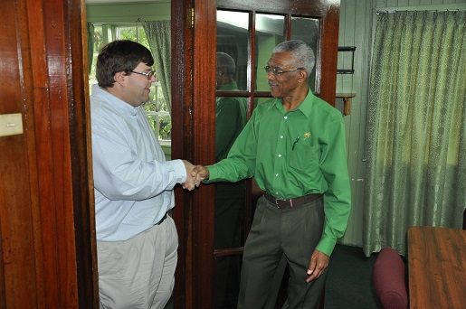 David Granger (right) greeting Bryan Hunt (APNU photo)