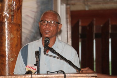 Poet and writer Patrick George reads a piece of his work on Friday at the launch of 15 new Guyana Classics titles by the Caribbean Press. He is among a set of published contemporary Guyanese writers.