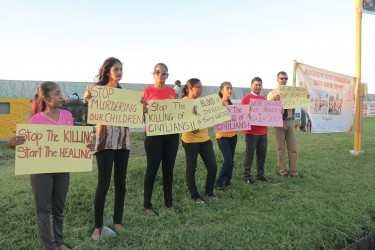 Members of the Progressive Youth Organisation, the PPP youth arm on Thursday protesting along the Rupert Craig Highway over the killings in Gaza.