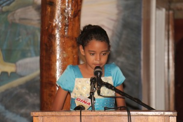 A girl recites a children's poem on Friday at the Umana Yana. Twenty Five Poems by Guyanese Children, an anthology edited by Rev. Gideon Cecil, was among the 15 new Guyana Classics titles launched by the Caribbean Press. (Photo by Arian Browne)