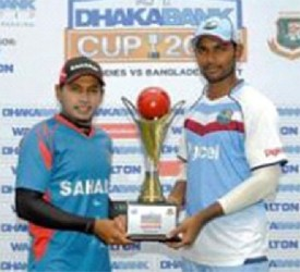 Captains Mushfiqur Rahim (left) and Denesh Ramdin pose with the series trophy yesterday.