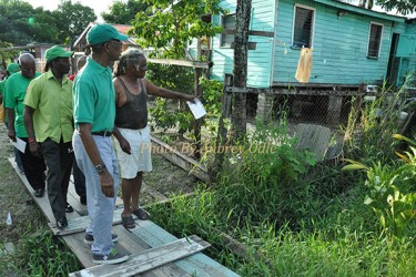 David Granger (left) being given a tour of the area (APNU photo)