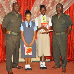 This GDF photo shows two of the awardees with members of the force.