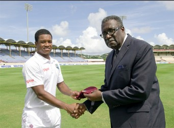 Leon Johnson, the 300th  West Indian to play test cricket receives his cap from the legendary former West Indies skipper Clive Hubert Lloyd yesterday. (Photo courtesy of WICB media)