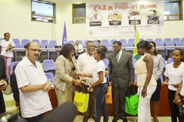 In this Government Information Agency (GINA) photo PAHO/WHO Director, Dr. Carissa Etienne (second from left) handing over testing equipment to members of the Wellness Warriors Club.