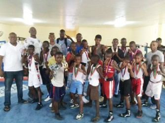 Boxers and officials pose for a photo opportunity yesterday following the conclusion of the Guyana Amateur Boxing Association Demerara Distillers Limited-sponsored U16 boxing championships at Andrew `Six Head' Lewis Gym.