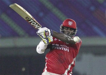 Thisara Perera muscles the ball down the ground, Kings XI Punjab v Hobart Hurricanes, Champions League T20, Mohali, September 18, 2014 (ESPNCricInfo)