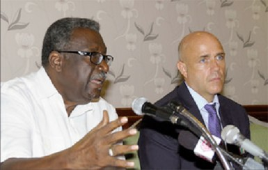 West Indies legend Clive Lloyd speaks as Richard Pybus, WICB Director of Cricket listens, during the signing of the a new Collective Bargaining Agreement and Memorandum of Understanding by WICB and WIPA on Thursday. (Photo courtesy of WICB Media Photo/Randy Brooks.)