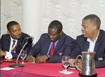 Wavell Hinds, WIPA President, signs the new CBA and MOU as Dave Cameron, WICB President and Michael Muirhead, CEO of WICB look on during the signing of the a new Collective Bargaining Agreement and Memorandum of Understanding by WICB and WIPA on Thursday. (Photo courtesy of WICB media)