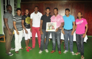 West Indies batsman Leon Johnson, who recently became the 300th cricketer to play for the West Indies in the 500th test match played by the regional side,  was last night honoured by the Georgetown Cricket Club (GCC) following his debut against Bangladesh in the second test  in Gros Islet, St Lucia September 13-17. Johnson, who at 16 made his first class debut for Guyana, has played club cricket for GCC. Above Johnson, third from right, shares the moment with some of his contemporaries from left, Joshua Wade, Elon Fernandes, Trevon Griffith, Christopher Barnwell, Robin Bacchus, Delon Fernandes and Vishal Singh. See details in tomorrow's issue. (Orlando Charles photo)