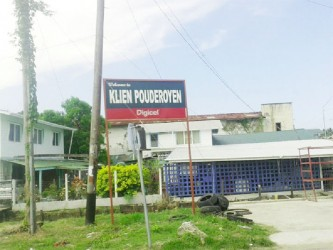 The Klein Pouderoyen sign stands firm next to 'Uncle Haroon's' shop.