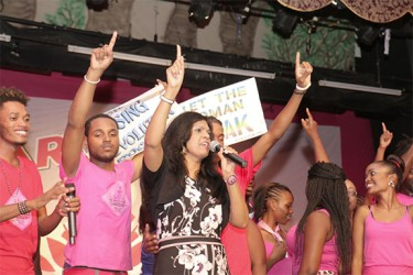 "Caribbean American Domestic Violence Awareness (CADVA) Programme Director Dianne Madray (third, left) showcasing the sign of solidarity to the One Billion Rising Movement to end violence against women at ""Let the Women Speak"" production held at Theatre Guild on Monday Night"