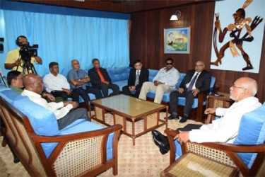 President Donald Ramotar meeting Executive Director of Pinnacle Green Resources Manu Bansal (third from right), IAST Head Dr Suresh Narine (extreme right) and other stakeholders. Also in photograph is Minister of Tourism, Industry and Commerce (ag) Irfaan Ali (second from right). (GINA photo)