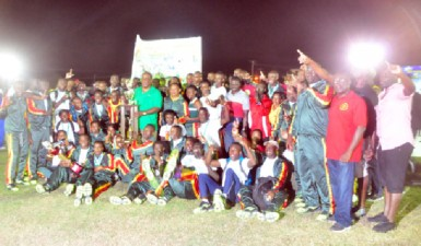 The GDF track and field outfit posing with the winner's Inter Services Annual Athletic Championship Trophy. (Orlando Charles photo)