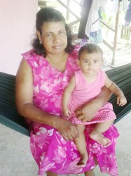 Kamwattie Toolsi and her granddaughter
