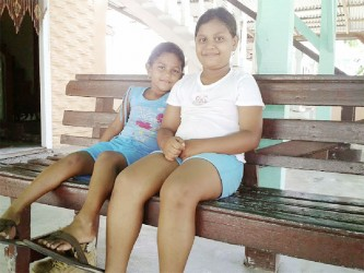 Two village girls sitting pretty