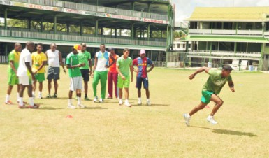 """Veteran batsman Shiv Chanderpaul showing his younger teammates how it's done during the """"Run of three"""" shuttle."""