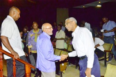 So what about that no confidence motion? President Donald Ramotar (centre) greets  Opposition Leader, David Granger at the Caribbean Baptists' Convention on Wednesday at the National Cultural Centre. This was a day after the President had announced that if the opposition proceeded with a motion of no-confidence against  his government he would either prorogue or dissolve Parliament. (GINA photo)