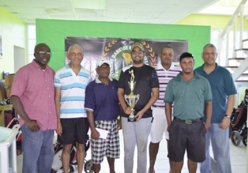 Flashback: George Bulkan (with Trophy) and members of the Underdogs team post with officials of Banks DIH and Citizens Bank at the Presentation Ceremony in February.