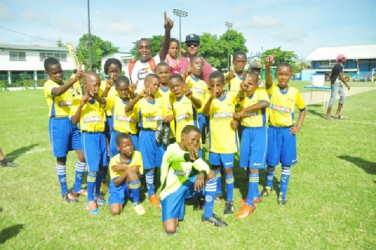 The Defending champions St Pius's football team celebrates following their emphatic win yesterday over Tucville Primary in yesterday's semi-final of the Petra Organisation/Courts Pee Wee football tournament. (Orlando Charles photo)