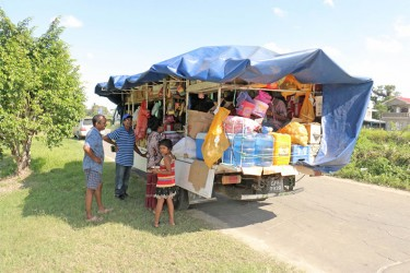 With customers in mind: A mobile variety store serving customers in Canal Number Two, West Demerara. The truck which drives through various communities touting its wares sells groceries, water and small haberdashery items. (Photo by Arian Browne)
