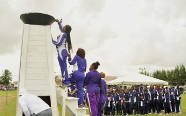District 11 athletes and teachers symbolically lighting the torch. (Orlando Charles photo)