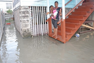 This woman and  her child were left marooned on Hogg St.