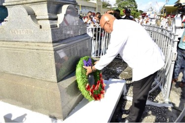Head of State, Donald Ramotar laying a wreath at the Cenotaph in observance of the fallen heroes of World Wars One and Two (GINA photo).
