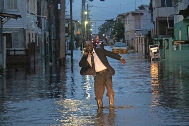 Suit and all but to navigate Albouystown required long boots this evening