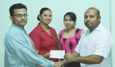 Brian Pertab Shipping Manager of Maersk (left) hands over the sponsorship cheque to LGC President David Mohamad in the presence of Maersk staff.