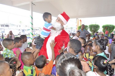 Children with Santa at one of the parties (Massy Group photo)