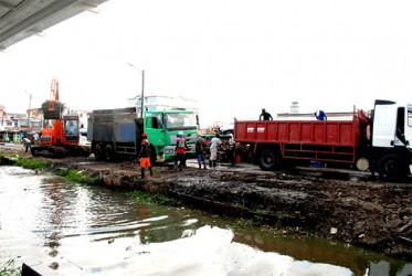 A small fleet of trucks was in attendance to 'cart off' the slush removed from the canal