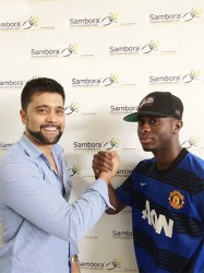 GFC Manager Faizal Khan (left) shakes hands with Trayon Bobb, his club's newest signee.