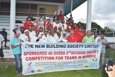 Rana Persaud, NBS Rose Hall Manager (left) presents the winner's trophy to D'Edward Captain Jaipaul Heeralall as other NBS staff, players from the victorious team and BCB officials look on.