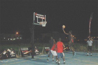 Ashton Adams of Raptors in the process of netting a jump shot during his side's close win over Plaisance Guardians in the Mackeson King of the Rim 3x3 Basketball Challenge