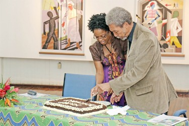 Stanley Greaves cuts his birthday cake at a ceremony held in his honour at Castellani House last month.