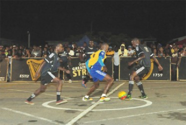 Sparta Boss's Sheldon Shepherd (centre) trying to win the ball from North Ruimveldt's Rickford James (no.5) in the middle of the playing area prior to his team's penalty shoot-out loss.