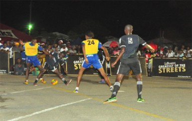 Devon Millington of Sparta Boss (left) tussling with Travis Grant (second left) of North Ruimveldt for possession of the ball during their team's semi-final showdown while Cleon Forrester (no.24) and Rickford James (no.5) look on.