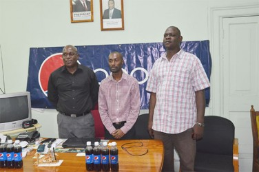 GBA's president, Steve Ninvalle (left), DDL's Brand Executive for Pepsi, Larry Wills (centre) and Technical Director of GBA, Terrence Poole  pose for a photo opportunity following yesterday's press briefing at the Ministry of Sport. (Orlando Charles photo)