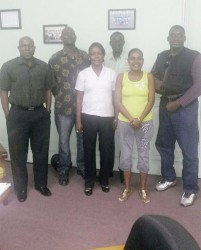 Suriname's Boxing Association president, Remie Burke (extreme right) poses with a photo with the top brass of the GBA. From left is president of the association, Steve Ninvalle; technical and tournament director, Terrence Poole; head of the referees/judges commission, Ramona Agard; national coach, Wincel Thomas; and secretary of the referee/judges commission, Nicola Yhap.