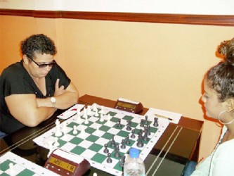 Cuban-Guyanese chess player Maria Varona-Thomas (left) is photographed defeating Trinidad and Tobago's Candidate Master Aditi Soondarsingh in Round 9 of the 2014 Guyana Umada Cup chess tournament. Maria, rated at FIDE 1738, finished the tournament in sixth place with 5.5 points, the same number of points as Loris Nathoo, Wendell Meusa, Su Hai Feng, and Surinamese Frank Kim Lin Lo and Geryen Dos Ramos. Anthony Drayton was adjudged the best Guyanese player of the Challenger's section of the tournament with his unassailable 6.5 points, finishing in 4th place, just under Jamaica's Woman International Master Deborah Richards who also accumulated 6.5 points.  Maria demonstrated excellent form in the earlier rounds of the tournament outplaying Su Hai Feng, Frank Kim Lin Lo, and Suriname's Calvin Finke before drawing with Jamaica's Andrew Mellace. She stopped Kriskal Persaud when he seemed to be on a rampage. Before that encounter, Kriskal had beaten Drayton. Maria represented Guyana at the 2014 Tromso Olympiad on fourth board.