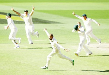 Nathan Lyon sets off in celebration after sealing Australia's win