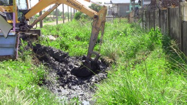 The excavator when it was used to clean the trenches in Sheet Anchor Village East Canje in August