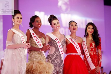 Miss Guyana World Rafieya Husain (right) on the Miss World competition stage in London after being named in the top 10 yesterday. (Miss World photo)