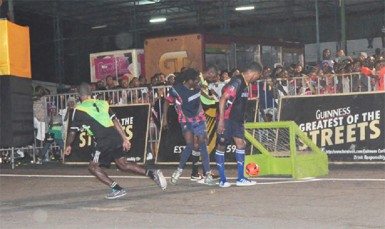 Travis `Zorro' Grant scores North Ruimveldt's second goal on the way to their upset win over Festival City  Warriors Sunday night in the Guinness Greatest of the Streets Georgetown finale. (Orlando Charles photo)