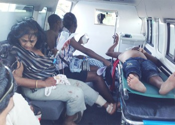 The driver of the car (at right) and other passengers about to be transferred to the Georgetown Public Hospital