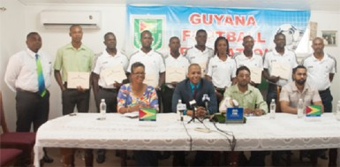 Members of the GFF Normalization Committee (sitting), GFF Referees Committee and FIFA accredited referees pose for a photo opportunity following the conclusion of the press conference held at the entity's Campbellville headquarters