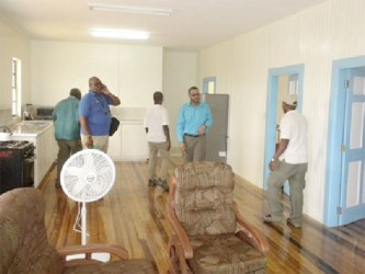 Minister of Natural Resources and the Environment, Robert Persaud (second from right) taking a look inside the new Geology and Mines Commission Building at Lethem. (GINA photo)