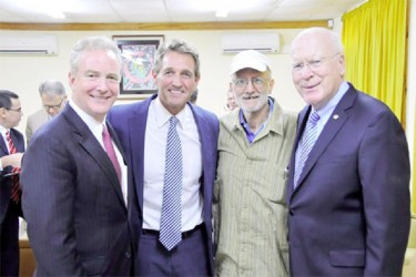 American aid worker Alan Gross (2nd R) poses after his release with L-R, U.S. Rep. Chris Van Hollen (D-MD), U.S. Sen. Jeff Flake (R-AZ), and U.S. Sen. Patrick Leahy (D-VT) at the airport in Havana, Cuba, yesterday in this photo tweeted by Rep. Van Hollen (Reuters photo)